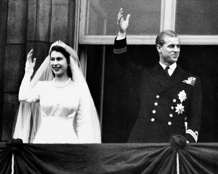 Princess Elizabeth and Prince Philip wave to the crowds from the balcony of Buckingham Palace in London on Nov. 20,1947 on their wedding day.