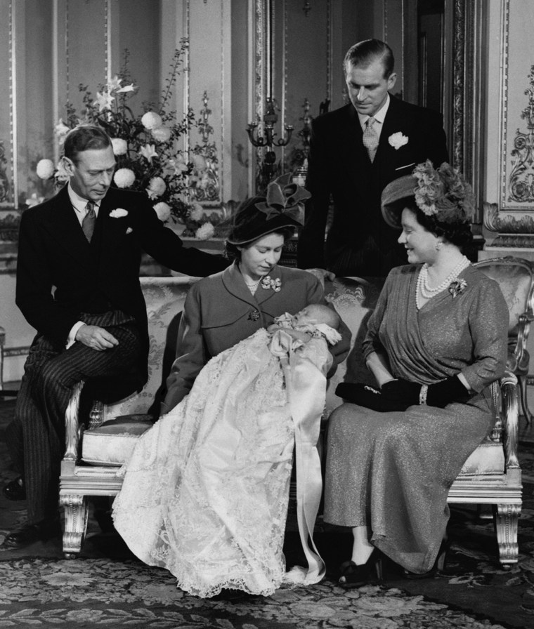 Members of the British Royal family gathered on Dec. 15, 1948 at Buckingham Palace for the christening of the month-old royal prince, who is being held by his mother, Princess Elizabeth. From left are the infant's grandfather King George VI, Princess Elizabeth, and Queen Elizabeth, his grandmother.  Standing in the rear is the prince's father, the Duke of Edinburgh.  The child was christened Prince Charles Philip Arthur George of Edinburgh.