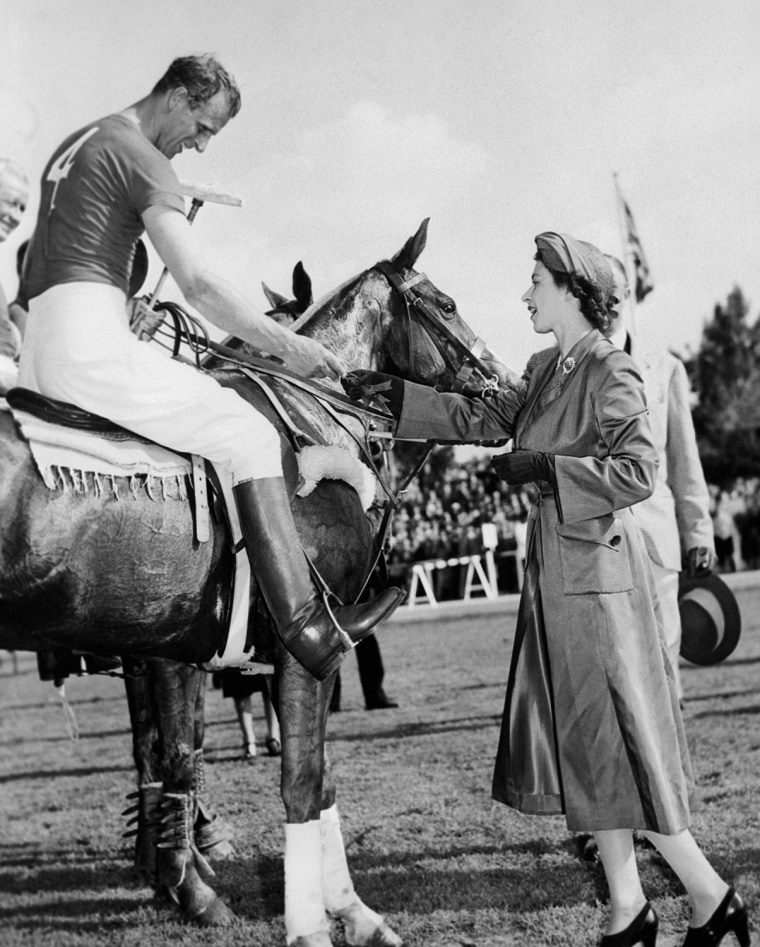 "Princes Elizabeth in Rome as she presents a souvenir medal to her husband,  the Duke of Edinburgh after his polo team ""The Optimist"" lost 9-4 in Italy on April 22, 1951."