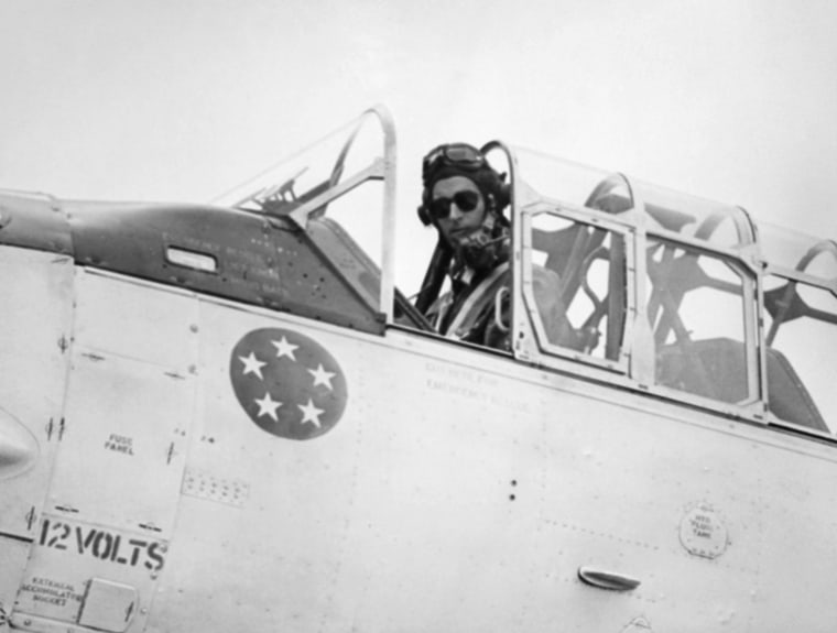 Prince Philip wears flying gear and sits in the cockpit of a Harvard training plane at England's White Waltham Airdrome  on May 4, 1953. Prince Philip passed his final test flight for Royal Air Force wings. The duke has been taking flying lessons for several months and has about 80 hours in the air to his credit. The five stars on the plane indicate his rank as air marshal.