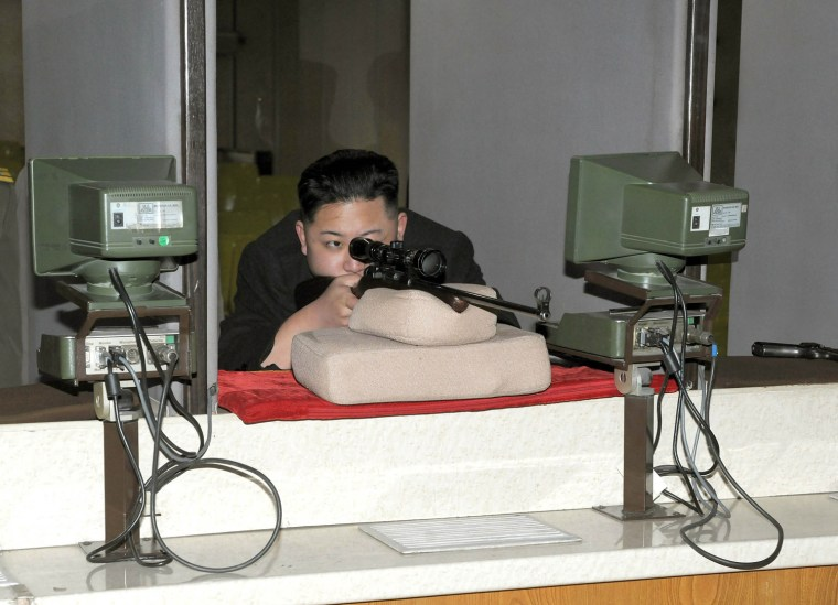 Image: North Korean leader Kim Jong-Un aims a rifle at the Sporting Bullet Factory