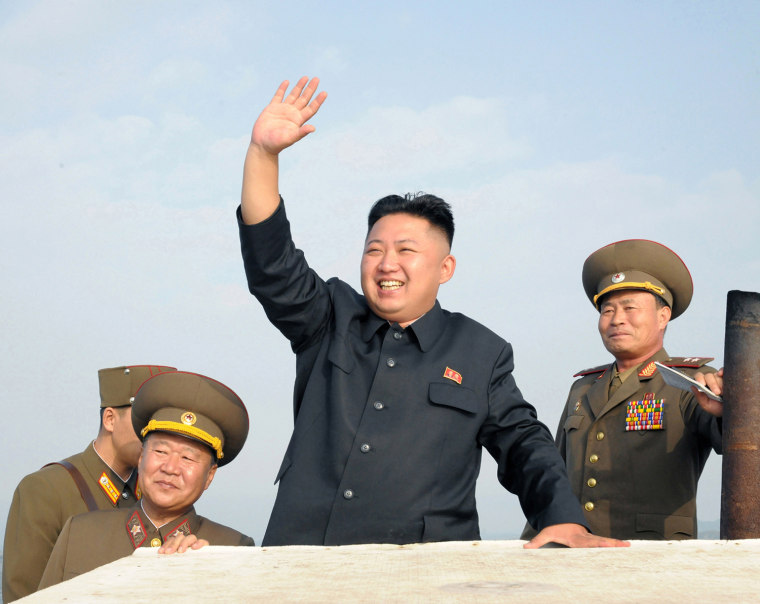 Image: File photo of North Korean leader Kim Jong-Un waves as he visits military units on islands in the most southwest of Pyongyang