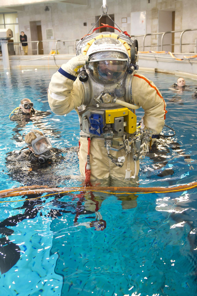 Image: Russian cosmonaut Alexander Samoukutyaev prepares to immerse in a swimming pool in a spacesuit as part of a training session at the Russian cosmonaut training facility in Star City outside Moscow