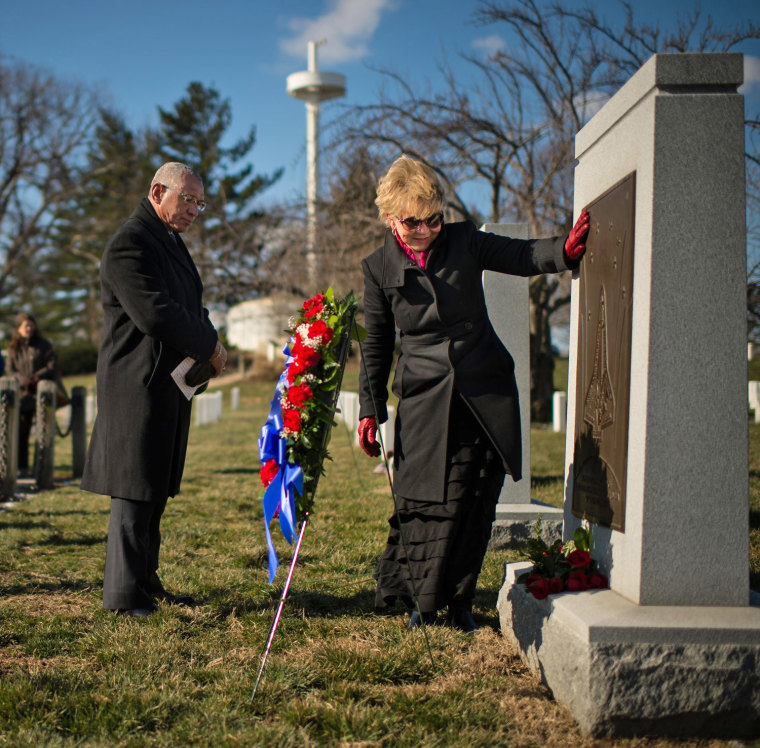 Image: NASA handout photo of June Scobee Rodgers and Charles Bolden visit the Space Shuttle Columbia Memorial at Arlington National Cemetery