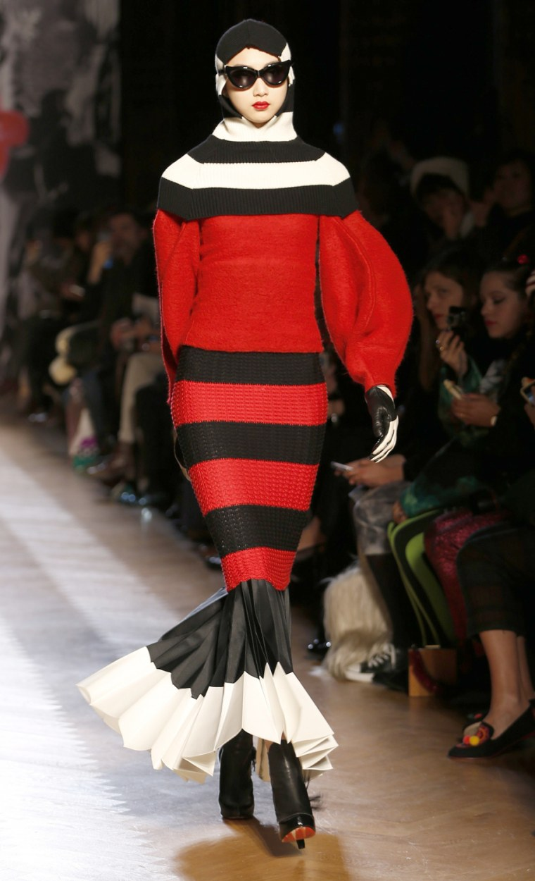 Image: A model presents a creation by Japanese designer Tsumori Chisato as part of her Fall-Winter 2013/2014 women's ready-to-wear fashion show during Paris fashion week