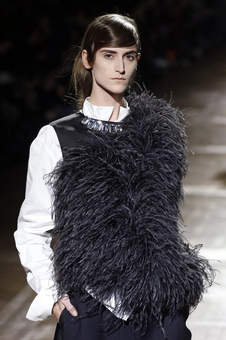 Image: A model presents a creation by Belgian designer Dries Van Noten as part of his Fall-Winter 2013/2014 women's ready-to-wear fashion show during Paris fashion week