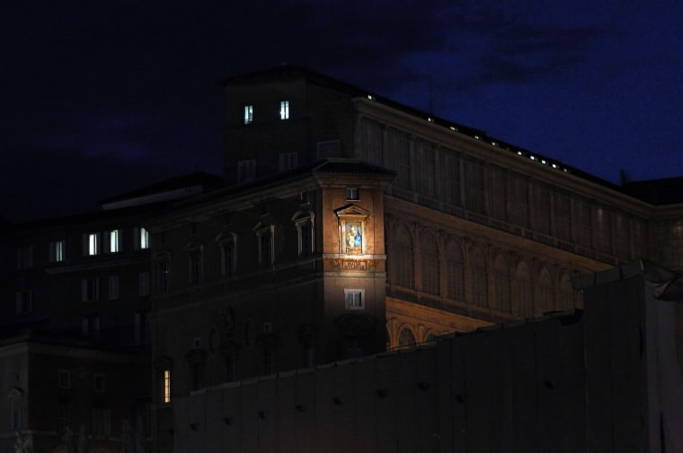 Image: A fresco of the Madonna is seen illuminated at the Vatican