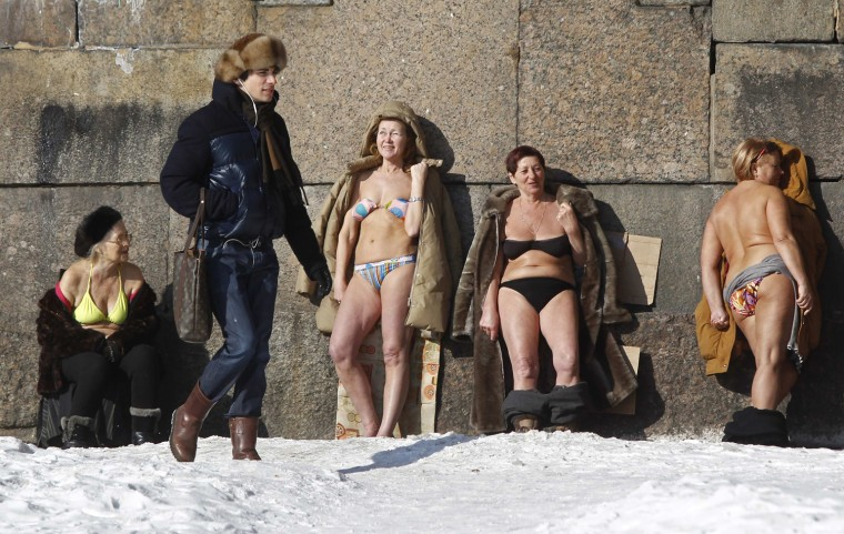 Image: People sunbathe by the wall of the Peter and Paul Fortress in St. Petersburg
