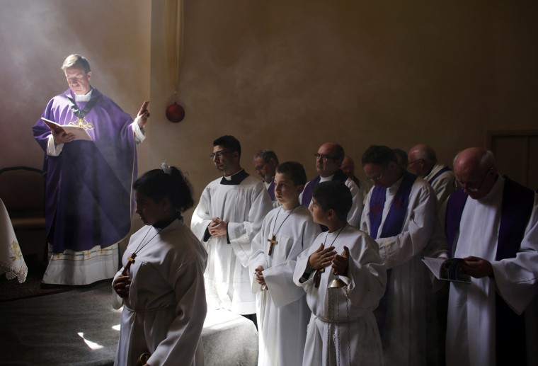 Image: Catholic clergy take part in morning prayer at the Al- Bishara Church in Beit Jala