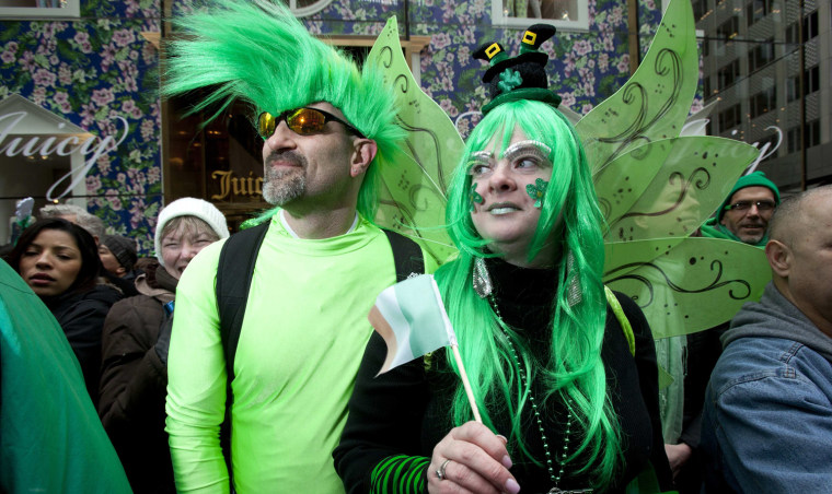 Image: Steven Anderson and Kimberly Anderson watch the St. Patrick's Day Parade in New York