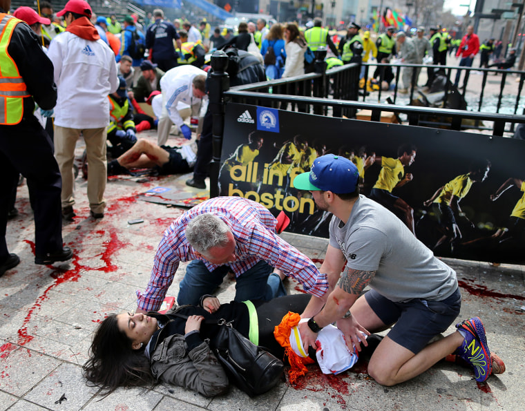 Image: Bystanders help an injured woman