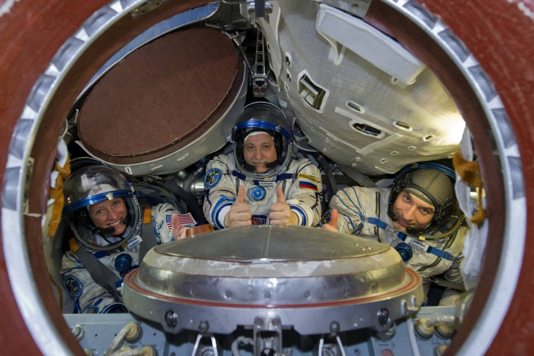 Image: European Space Agency astronaut Parmitano, NASA astronaut Nyberg and Russian cosmonaut Yurchikhin pose for a picture at the Star City cosmonaut training centre outside Moscow