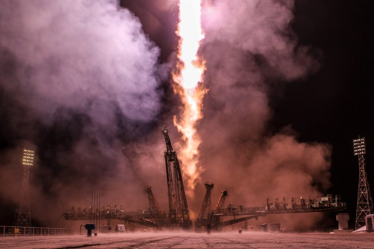 Image: A rocket booster carrying the Soyuz TMA-08M spacecraft take off