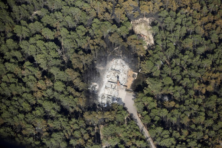 Image: An aerial view of a destroyed house surrounded by dense forest in the aftermath of the Black Forest Fire in Black Forest, Colorado
