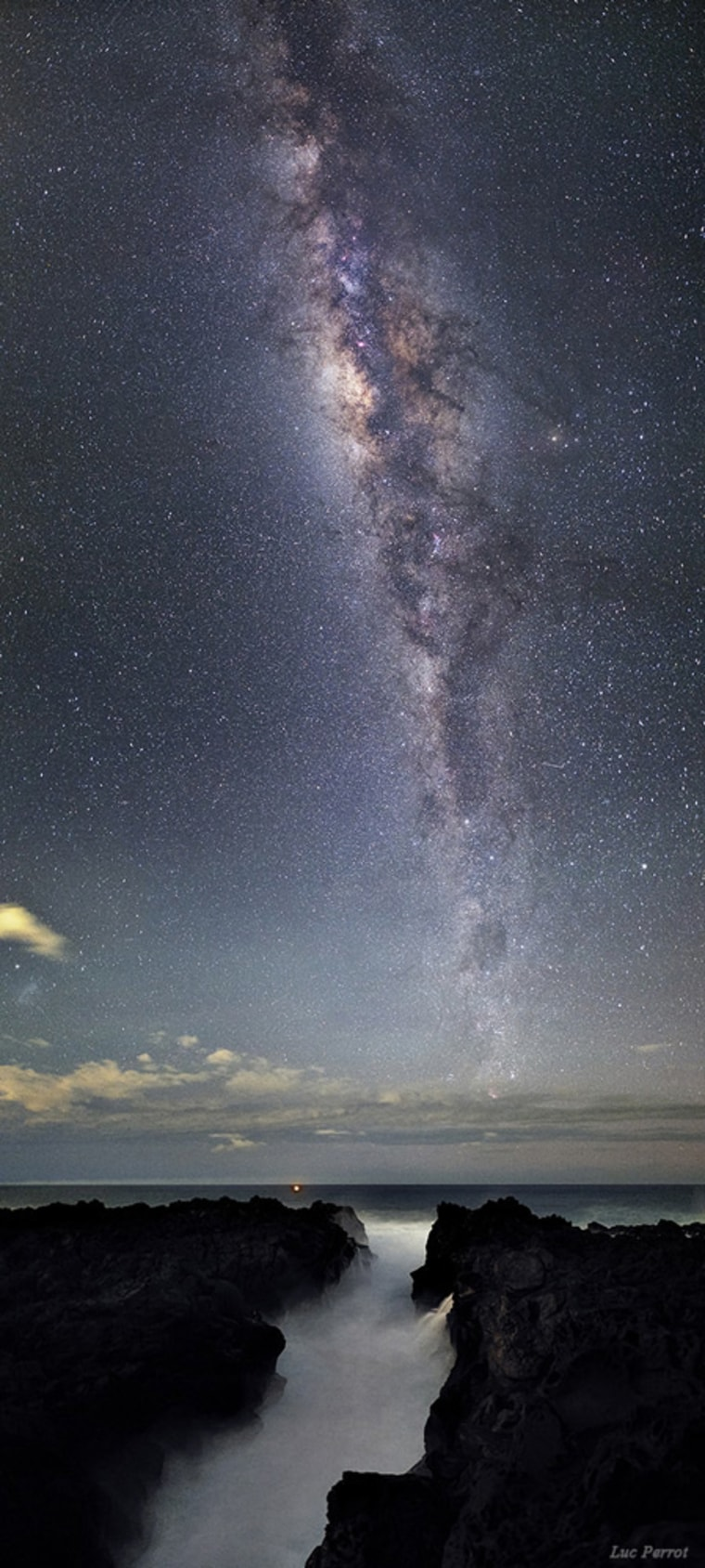 """Crossed Destinies,"" the Milky Way over Reunion Island in the Indian Ocean by Luc Perrot of France (www.lucperrot.fr). This image was the 2nd winner in the the Beauty of the Night Sky category."