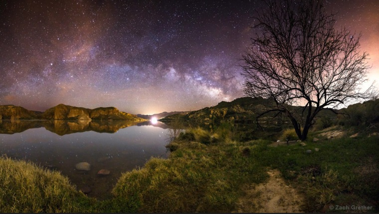 Stars and lights at a canyon lake near Globe, Ariz., by Zach Grether (www.zgrethphoto.com). This image was the 2nd winner in the Against the Lights category.