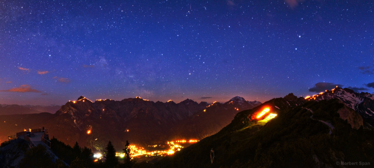The Milky Way over the Alps during a summer solstice fire festival in Tryol, Austria, by Norbert Span. This image was the third winner in the Against the Lights category.