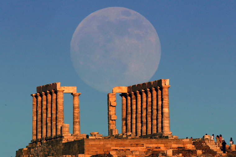 Image: The moon rises over the temple of Poseidon in Cape Sounion east of Athens