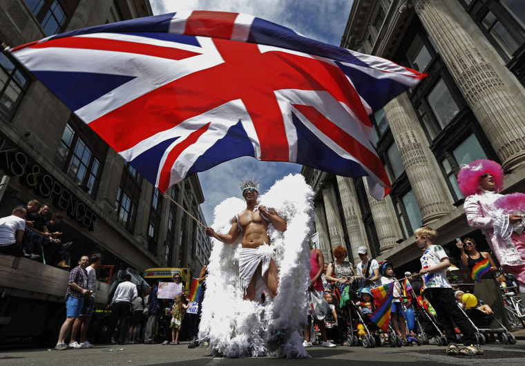 Image: A participant waves a Union flag during the annual Pride London parade
