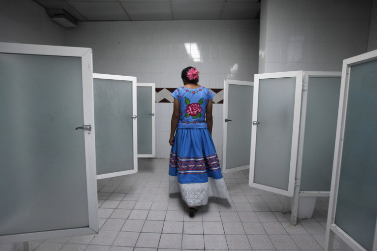 "Image: Roberto,  dressed as traditional Zapotec also known as ""Muxe"", walks inside women's bathroom during traditional party in Mexico City"