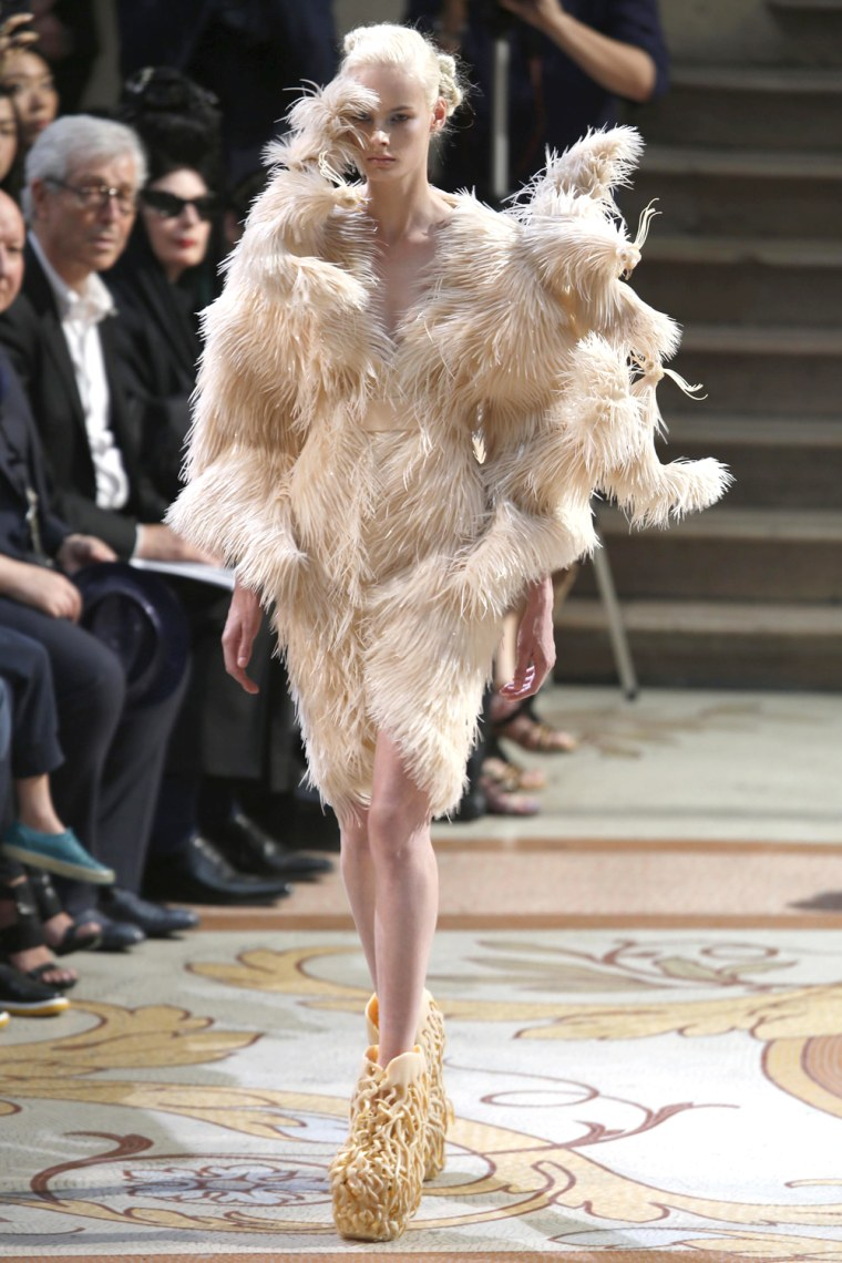 Image: A model presents a creation by designer Iris van Herpen as part of her Haute Couture Fall Winter 2013/2014 fashion show in Paris