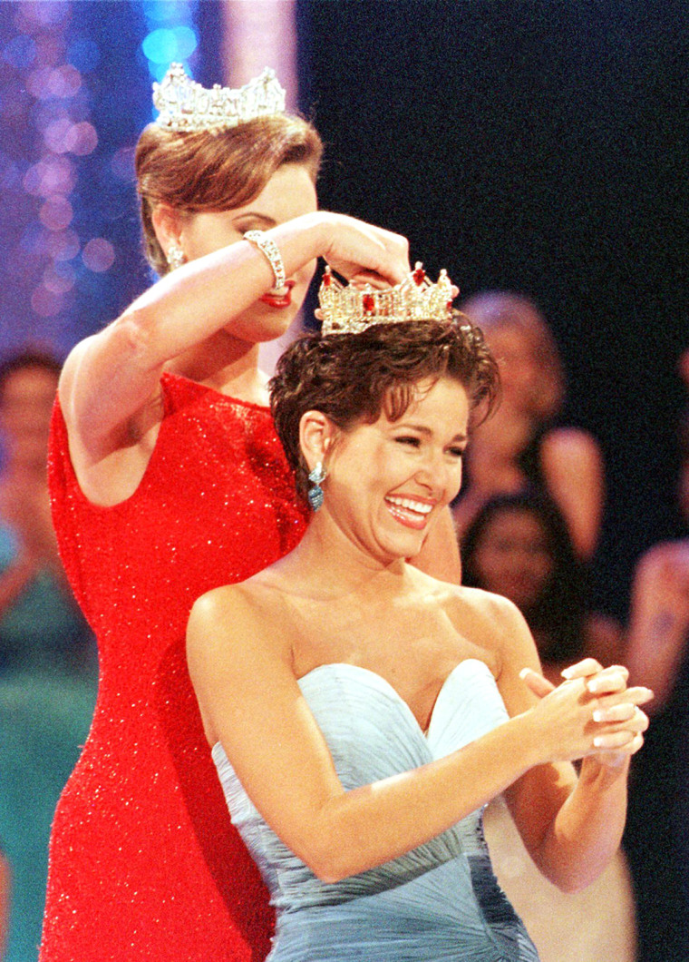 Heather Renee French (R), Miss Kentucky, reacts as