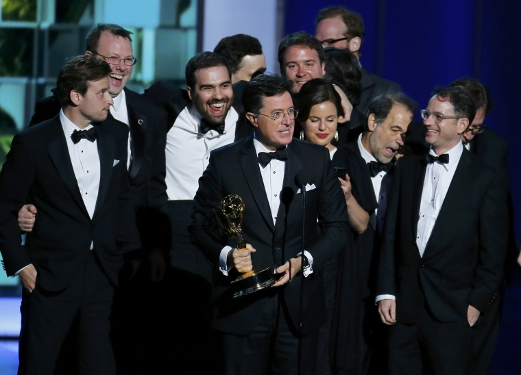 "Image: Colbert accepts the award for Outstanding Variety Series for ""The Colbert Report"" at the 65th Primetime Emmy Awards in Los Angeles"