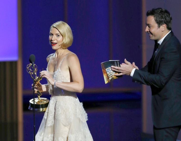 "Image: Actress Danes accepts the award for Outstanding Lead Actress In A Drama Series for her role in ""Homeland"" from presenter Fallon at the 65th Primetime Emmy Awards in Los Angeles"