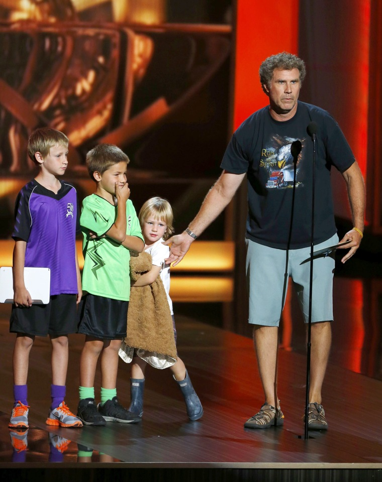 Image: Presenter Will Farrell takes the stage with his children to present the Outstanding Comedy Series and Outstanding Drama Series