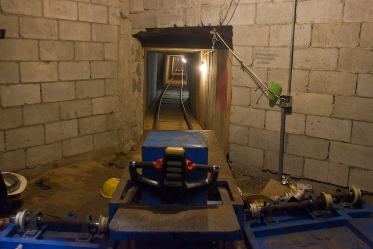 View of a trans-border tunnel and wagons
