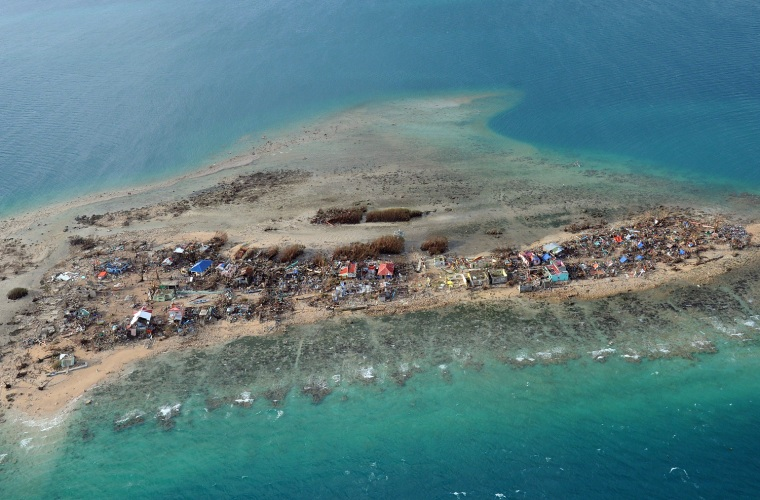 Image: An aerial photo shows the devastation on Victory Island off of the town of Guiuan, central Philippines