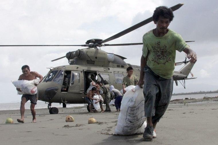 Image: PHILIPPINES-WEATHER-TYPHOON-AID