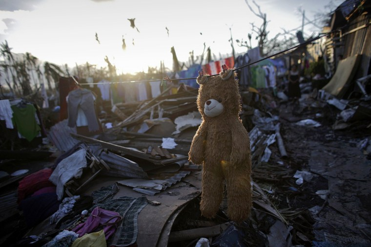 Image: A teddy bear is hung out to dry in a part of Tolosa devastated by Typhoon Haiyan