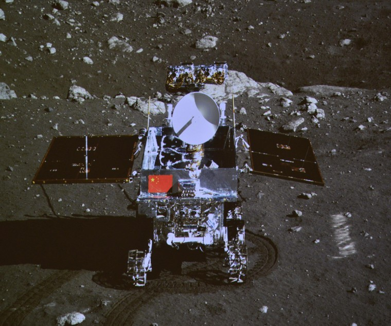 """Image: A photograph of the giant screen at the Beijing Aerospace Control Center shows photo of the Yutu, or \""""Jade Rabbit\"""" lunar rover taken by the camera on the Chang'e 3 probe during the mutual-photograph process, in Beijing"""