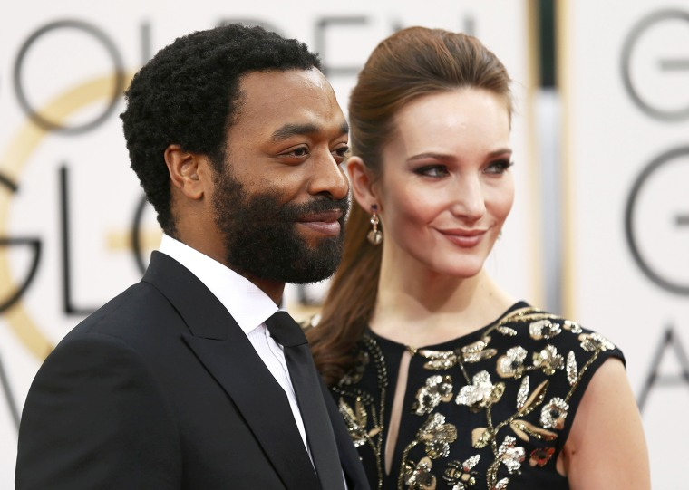Image: Chiwetel Ejiofor and Sari Mercer arrive at the 71st annual Golden Globe Awards in Beverly Hills