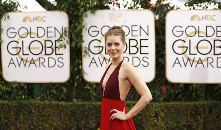Image: Actress Amy Adams arrives at the 71st annual Golden Globe Awards in Beverly Hills