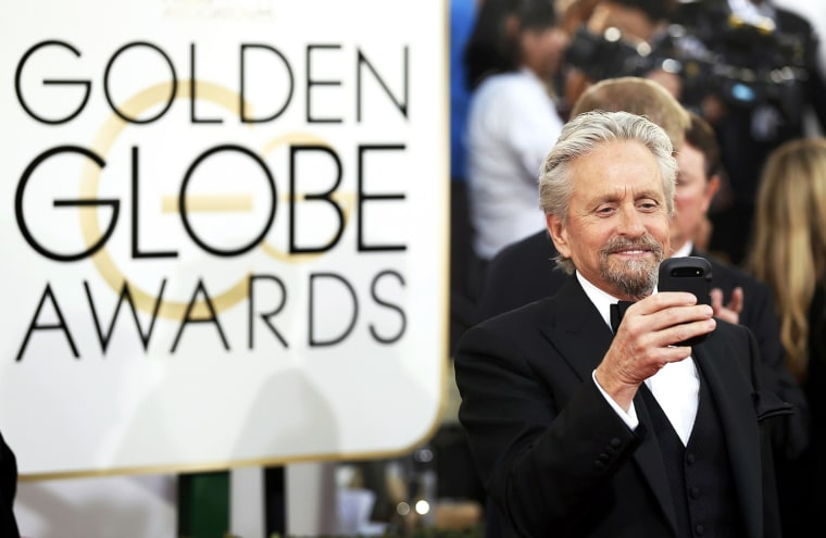 Image: Michael Douglas arrives at the 71st annual Golden Globe Awards in Beverly Hills