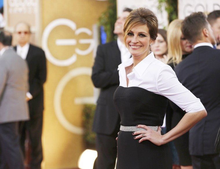 "Image: Actress Julia Roberts from the film ""August: Osage County"" arrives at the 71st annual Golden Globe Awards in Beverly Hills"