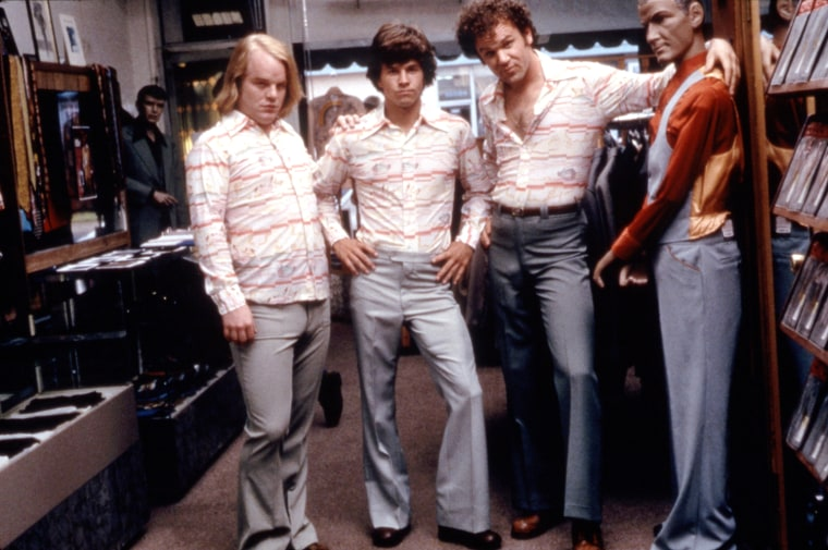 BOOGIE NIGHTS, Philip Seymour Hoffman, Mark Wahlberg, John C. Reilly, 1997. (c) New Line Cinema/ Courtesy: Everett Collection.