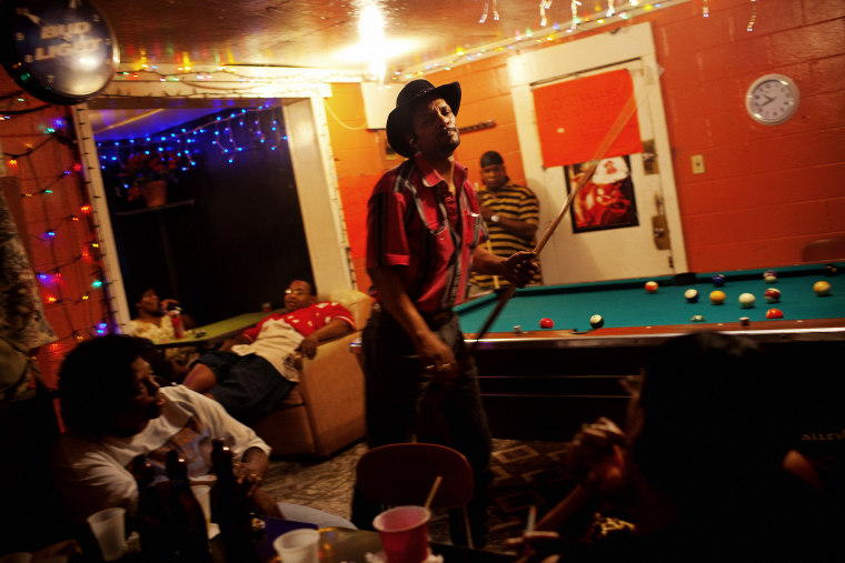 Dwight Harris plays pool in Odessa Nicks' one-room bar in Baptist Town, Mississippi on Saturday, May 22, 2010.