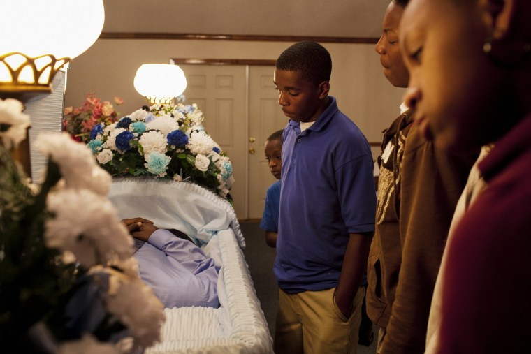 """The wake of Demetrius """"Butta"""" Anderson, 18, in Greenwood, Mississippi on Thursday, November 4, 2010. Butta was shot and killed on October 27, 2010 by a man he had assaulted a year before. His older brother was shot and killed in 1996 and his cousin, Bianca Keys, was also 18 when she was murdered in 2009. Butta's girlfriend was pregnant with his first child, due barely a month after his death. Violence seems to be an accepted part of life within this part of the community as the cycles of poverty perpetuate."""