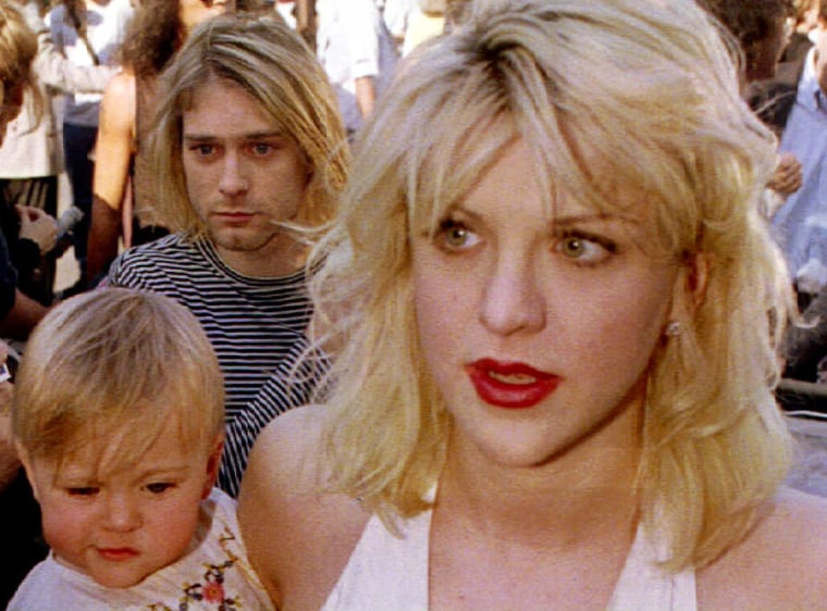 Image: File photo of Kurt Cobain arriving with wife Courtney Love, holding their daughter Frances Bean Cobain, for the MTV Music Awards show in Los Angeles