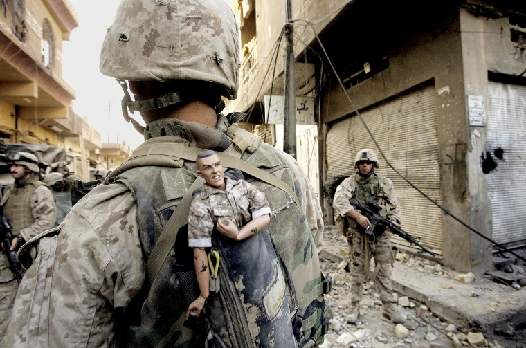 ** FILE ** This photograph is one in a portfolio of twenty taken by eleven different Associated Press photographers throughout 2004 in Iraq.  A U.S. Marine of the 1st Division carries a mascot for good luck in his backpack as his unit pushed further into the western part of Fallujah, Iraq, Sunday, Nov. 14, 2004. The Associated Press won a Pulitzer prize in breaking news photography for the series of pictures of bloody combat in Iraq. The award was the AP's 48th Pulitzer. (AP Photo/Anja Niedringhaus)