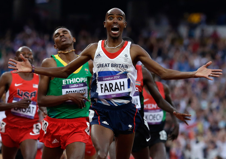 Britain's Mohamed Farah celebrates as he crosses the finish line to win the men's 5000-meter final during the athletics in the Olympic Stadium at the 2012 Summer Olympics, London, Saturday, Aug. 11, 2012.(AP Photo/Anja Niedringhaus)