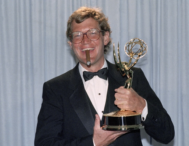 Comedian  David Letterman holds his award at the 37th Annual Primetime Emmy Awards ceremony in Pasadena, Ca., Sunday, Sept. 22, 1985. (AP Photo/Nick Ut)