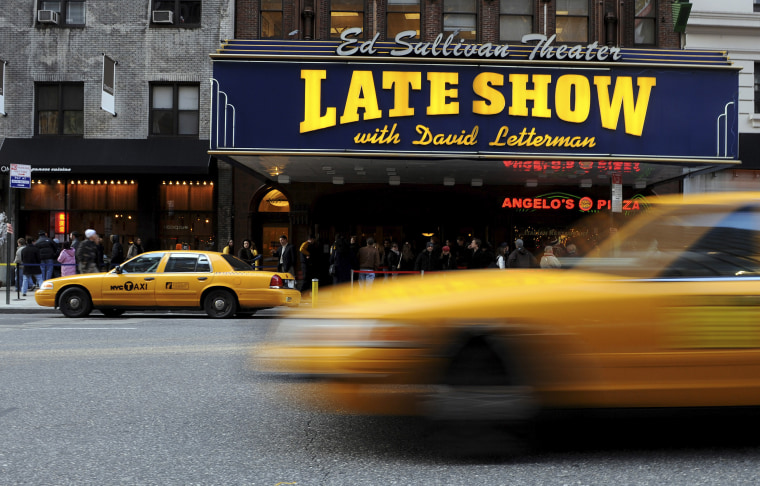 "Ticket holders wait in line to enter the Ed Sullivan Theatre to watch the first episode of the ""Late Show with David Letterman"" to air since Letterman's production company struck a deal to allow writers to come back to work, Wednesday, Jan. 2, 2008, in New York.  (AP Photo/Peter Kramer)"