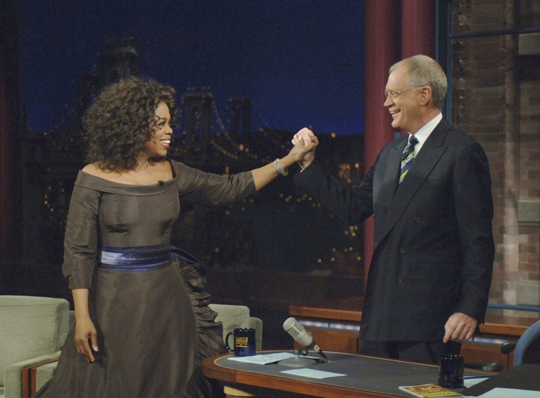 "Oprah Winfrey returns to chat with David Letterman, 16 years after her previous visit on The Late Show with David Letterman, December 1, 2005 on the CBS Television Network. Following the interview, Dave escorted Oprah across 53rd street to the opening of her new Broadway Show ""The Color Purple"".  Photo: Jeffrey R. Staab/CBS  ©2005 CBS Broadcasting Inc. All Rights Reserved"