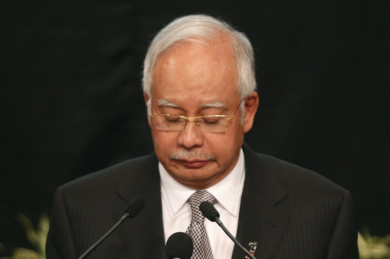 Image: Malaysia's Prime Minister Najib Razak makes an announcement on the latest development on the missing Malaysia Airlines MH370 plane at Putra World Trade Center in Kuala Lumpur