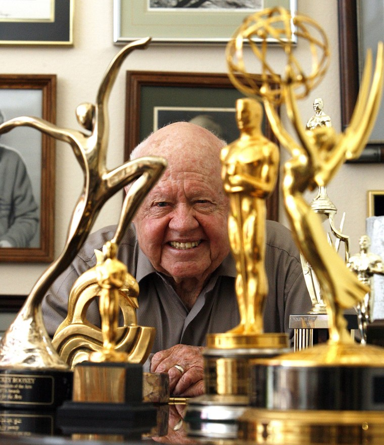 Image: File photo of actor Mickey Rooney smiling in front of his trophies during an interview with Reuters at his home in Westlake Village