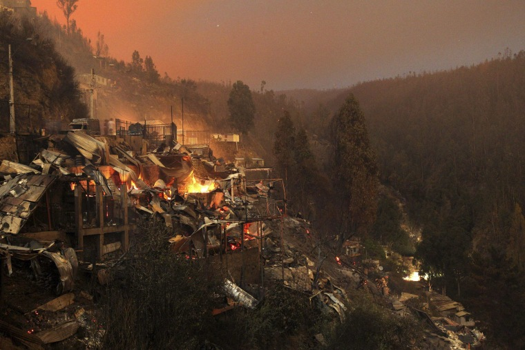 Image: Destroyed houses are seen at the location where a forest fire burned several neighbourhoods in the hills in Valparaiso city, northwest of Santiago